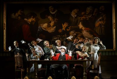 """The cast with John Rapson as Lord Adalbert D'Ysquith (red) in a scene from """"A Gentleman's Guide to Love & Murder."""" Photo credit: Joan Marcus."""